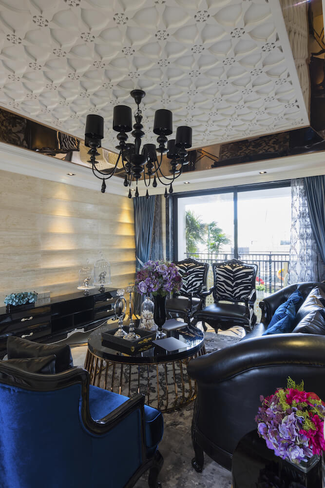 We typically think of coffered ceilings as square, but this unique sunburst style is an incredible example. The ceiling is rimmed with a metallic material that reflects the furniture below.