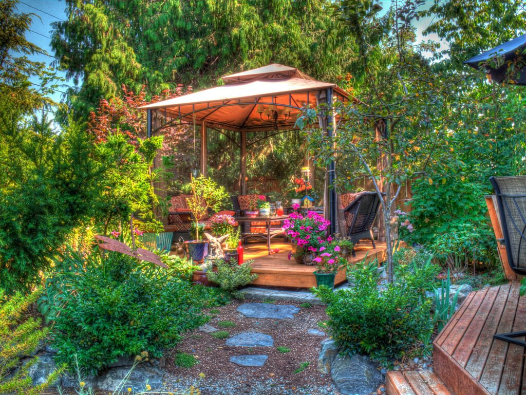This beautiful metal pavilion is consumed by the flowers that surround it. This is an amazing escape for any green thumb who wants to be among lovely flowers.
