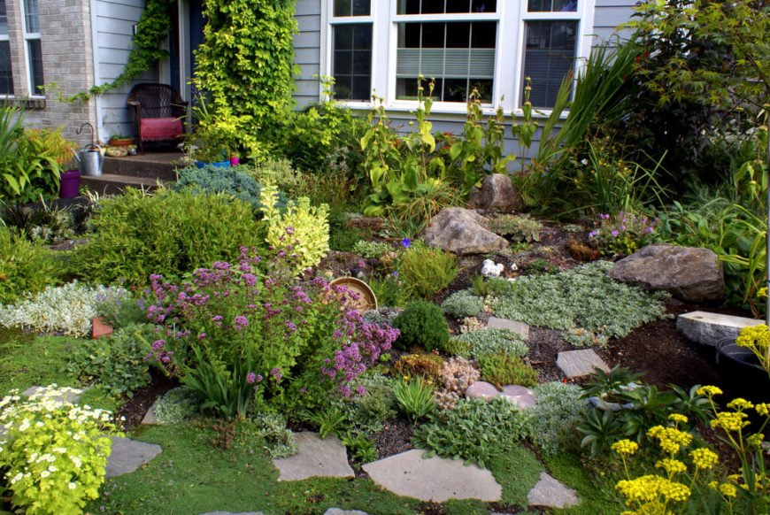 If your rocks have flat surfaces they may be able to be used as stepping stones. This can make getting around your garden have less of an impact on flowers and other plants.
