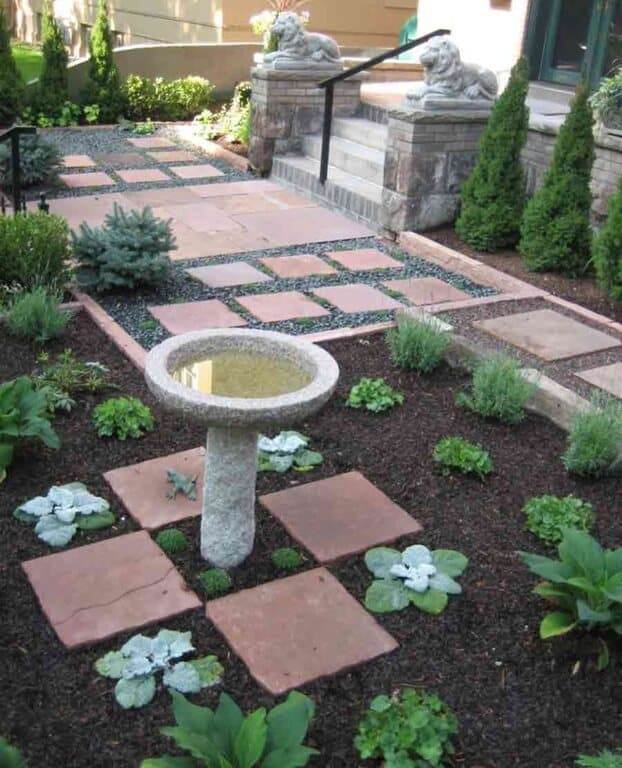 This bird bath's stone construction has a great deal of texture to offer a space. This is a very simple design. With a design this simple you can build it into almost any yard style.