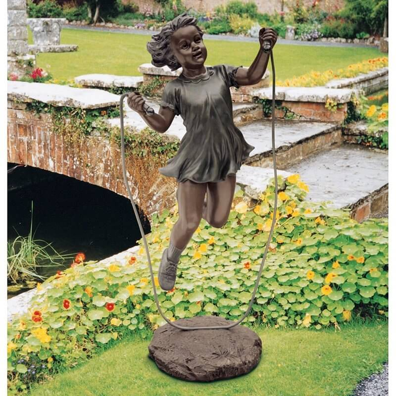 Some sculptures are designed to create intrigue in the viewer. Here is a sculpture of a girl jumping rope that appears to be breaking the laws of physics. The girl is hovering in the air, drawing attention and inspiring intrigue.