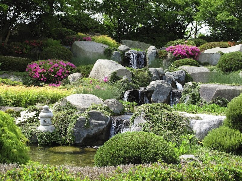 Stacking very large rocks creates a very interesting and wild looking yard area. You can build your own mini mountain in your own backyard.