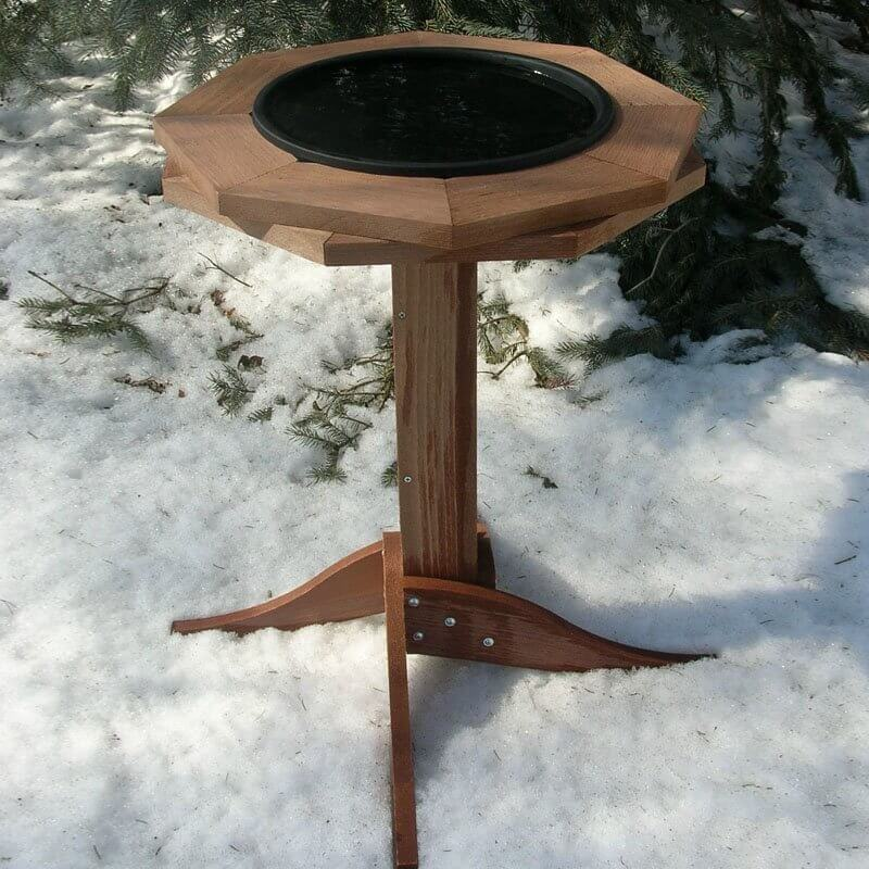 Here is an interesting bird bath with a wooden stand and a resin basin. This is a sleek and appealing bird bath that stands out from other models.