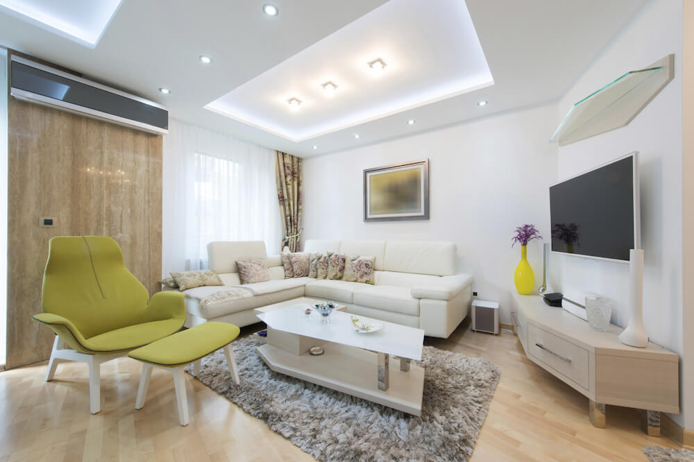 The lighting in the tray ceiling above the contemporary, small living room takes full advantage of the usable space while adding architectural interest to the space.