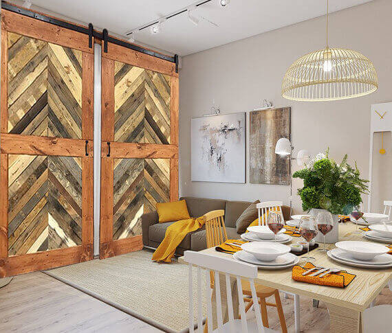 The chevron pattern of these double sliding barn doors are created using different colors and textures, resulting in a lovely contemporary version of the rustic doors.