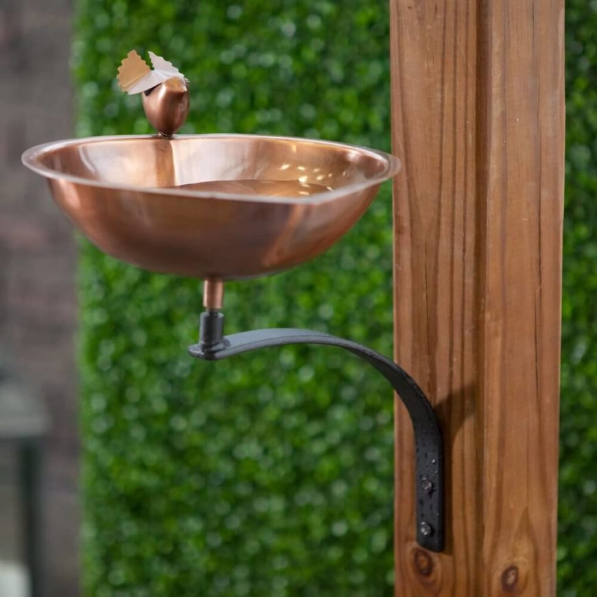 This little copper bird bath hangs from a post. A copper bird bath such as this is both minimalistic and modern. People and birds alike will be attracted to the forward thinking design of this cutting edge bird bath.