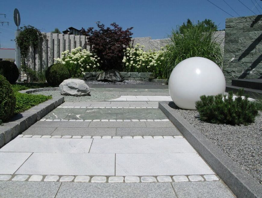 Even having one type of perennial bush around a feature can help bring that feature out. These flowers help highlight the landscaping choices by directing the eye through the space.