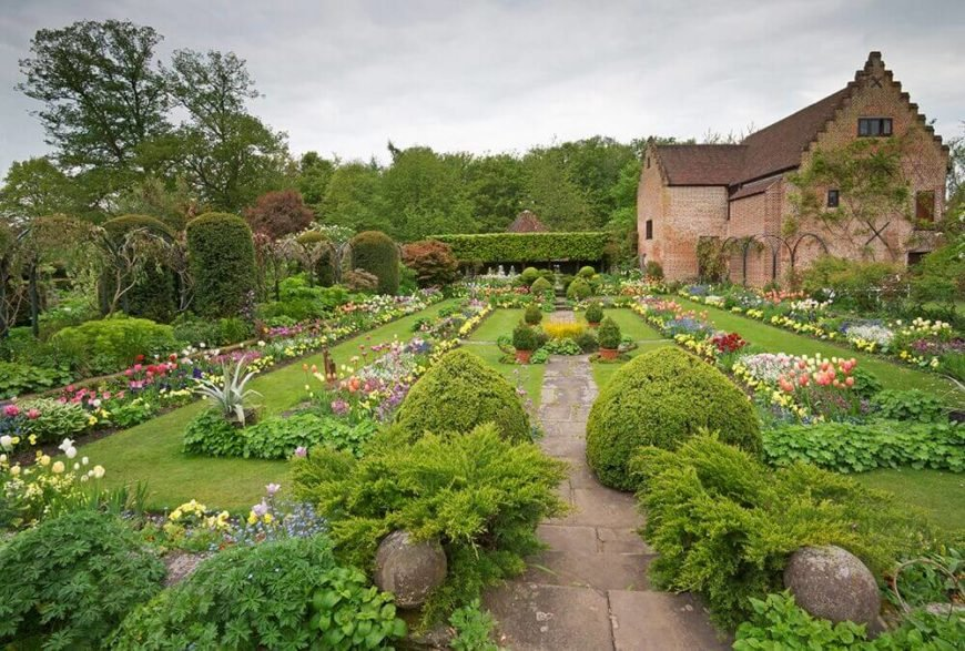 Here is a vast landscape with a number of perennials. In a space this large it is wise to plant flowers you won't have to replant every year. This is a fair amount of space to cover by means of replanting.