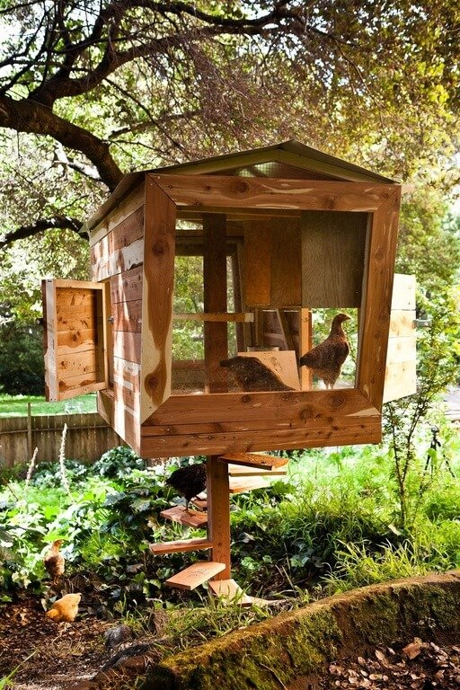 One of the most innovative chicken coop designs we've seen, this elevated unit features a spiral staircase for entry and plenty of large openings for the birds to enter and exit.