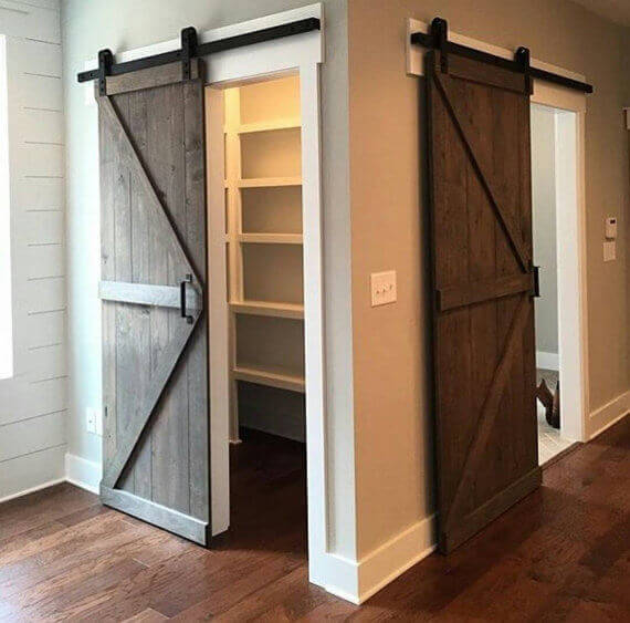 A simple sliding barn door is a great way to close off a closet with style and substance without dealing with regular doors, which need space to swing open and closed.