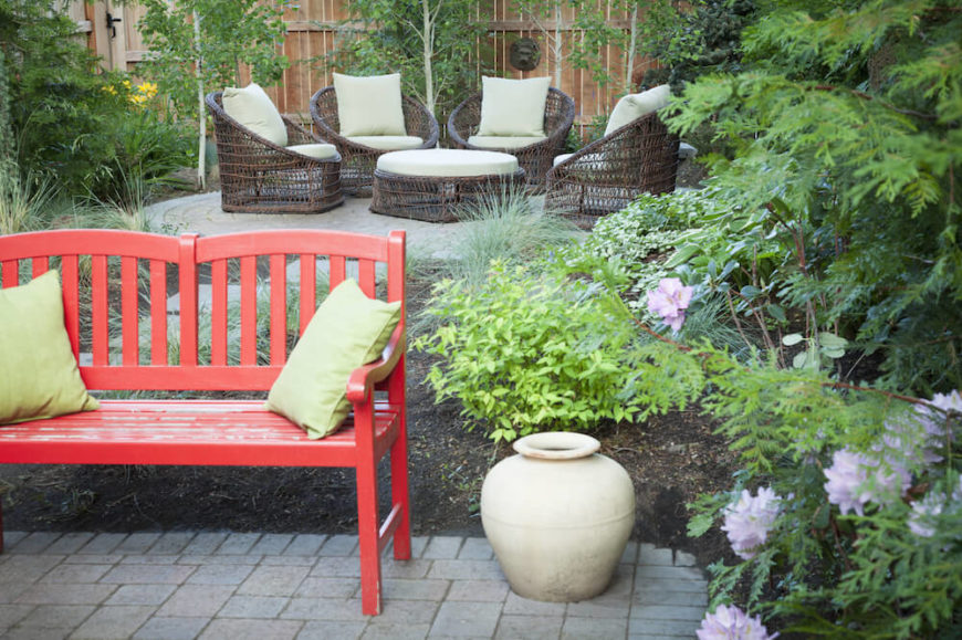 As with indoors, accent furniture outside can spice up your space and make your area pop. A bench is a great place to have an accent piece. A simple bench of a different color or style is perfect to bring some contrast to your design.