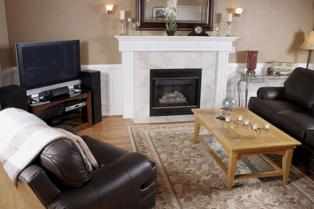 A beautiful marble fireplace in a contemporary living room and family room.