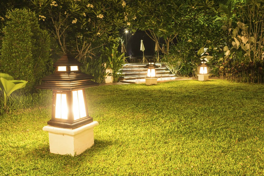 There are many different kinds of lanterns that can be used in your yard. Some are very minimal and provide light without making much impact on your design. Others have a very strong design presence and can be used to great effect to create a specific ambiance.