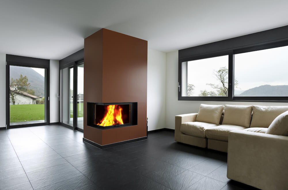 Corner fireplaces have the appeal of being able to be presented to more than one angle of the room. Painting this one a bold color enforces its effect as a focal point.