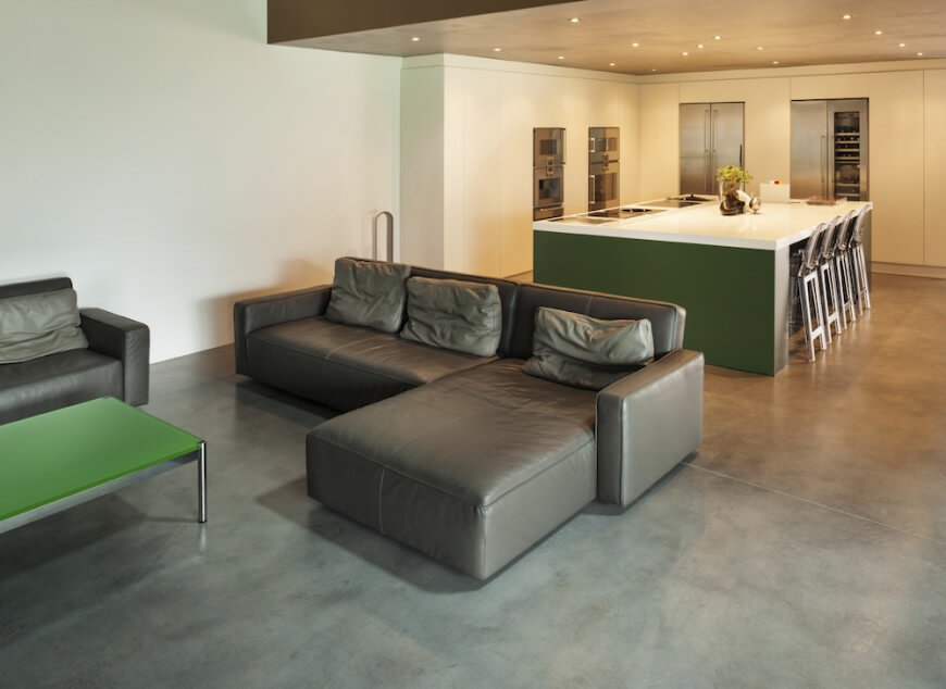 Concrete floors are clean and simple. They are perfect for minimalist designs. There is no fluff or unnecessary elements. It is just a sturdy and functional flooring option.