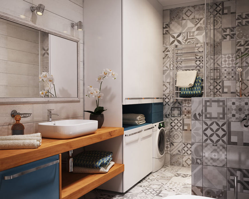 Rover_AptVerbi_06 As is the case in many apartments, the main bathroom is also the laundry room. This bathroom utilizes eye-popping patterns paired with the natural grain of wooden countertops. A few bold jewel colors are mixed in as well to break up the monochromatic color scheme.