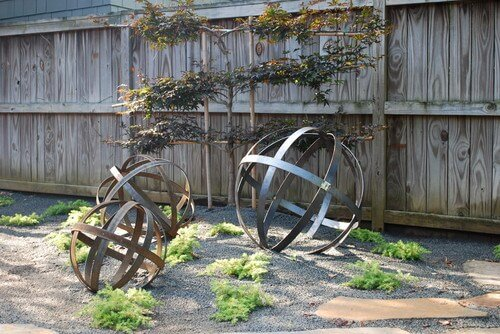 Some sculptures are incredibly simple. Here there are three large metal spheres. These shapes are visually interesting and simple so that they can work in almost any space.