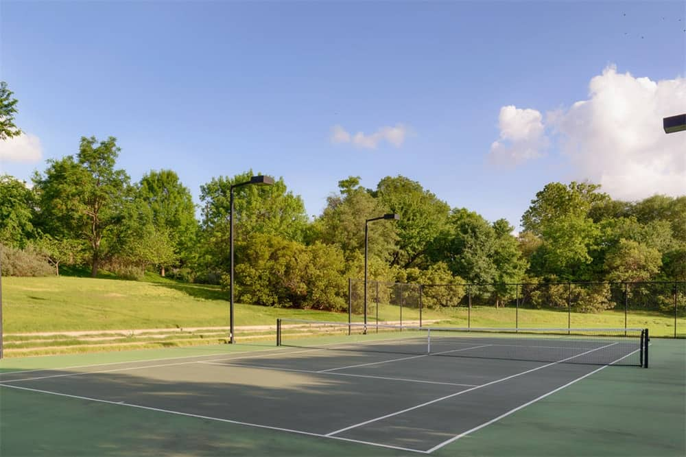 This is the large tennis court of the estate surrounded by lush green lawns of grass and tall trees that set a lovely background. Images courtesy of Toptenrealestatedeals.com.