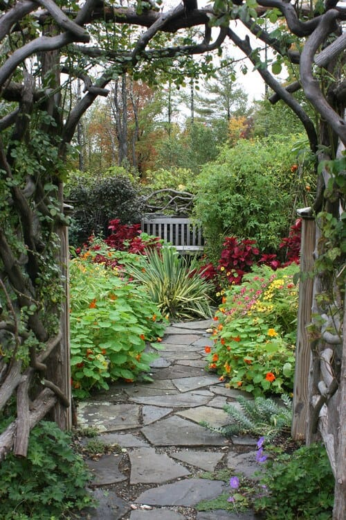 If you have a large and interesting garden you can use it as an escape. Put up a knotted wood arch and a bench and your space goes from garden to mystical escape.