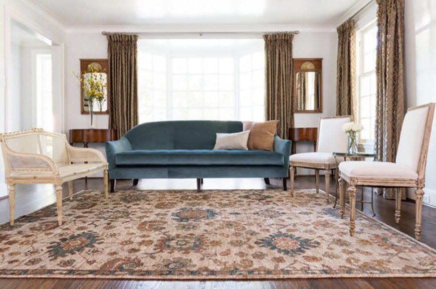 A multi-colored and intricately designed beige rug can transform a dining or living room into a refined and cosmopolitan space.