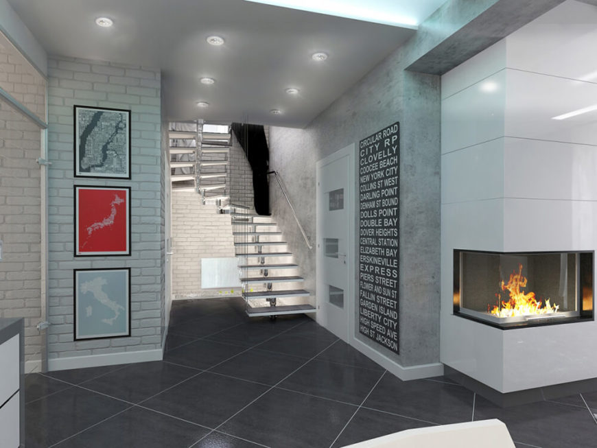 Next to the main entry door, we see the open design steel staircase, leading to the private areas of the home. Light brick accents the interior here with a dash of rich texture.