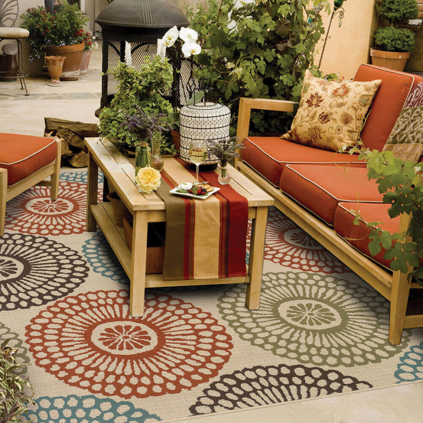 Ideal for outdoor patios or sunrooms, this rug offers a modern playful spin on traditional ornate rugs.