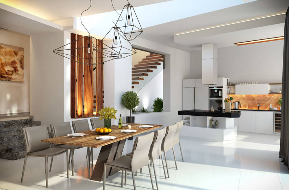 The large central area of the home mixes living, dining, and kitchen functions within the same set of walls. Here the striking, modern hardwood dining table stands in contrast with its stark white surroundings.