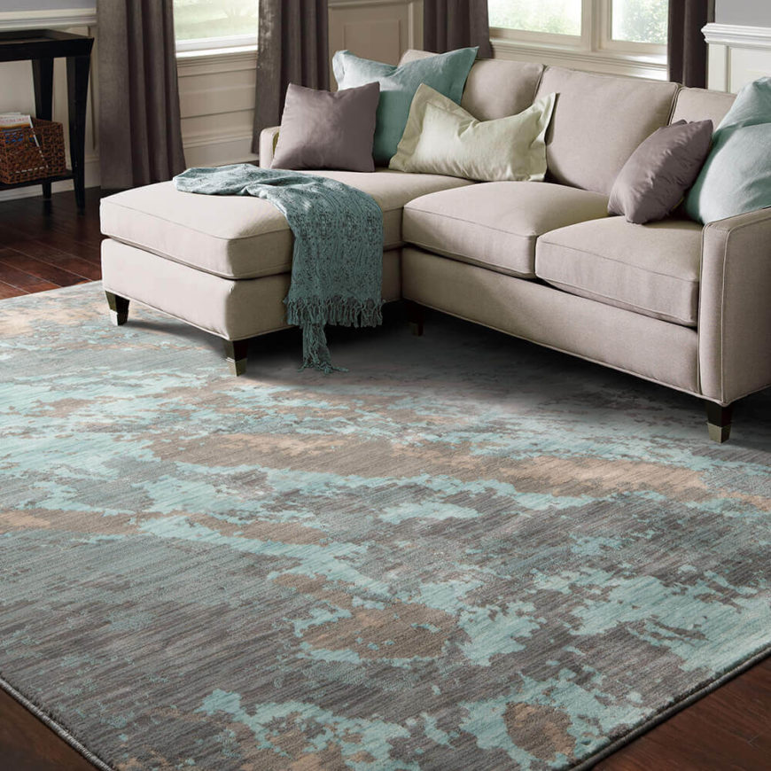 With splashes of aqua, this rug feels airy and light and is a perfect for adding warmth to laminate, tile, or hardwood flooring.