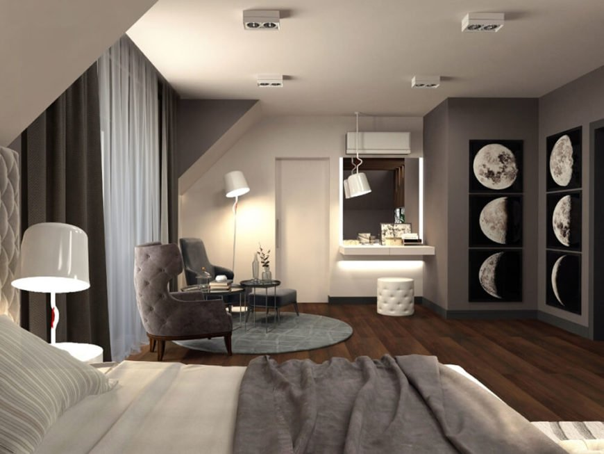 The space theme is furthered by a set of artful moon photographs in one corner. Next to this, a sleek vanity sits near the en suite bathroom entry.