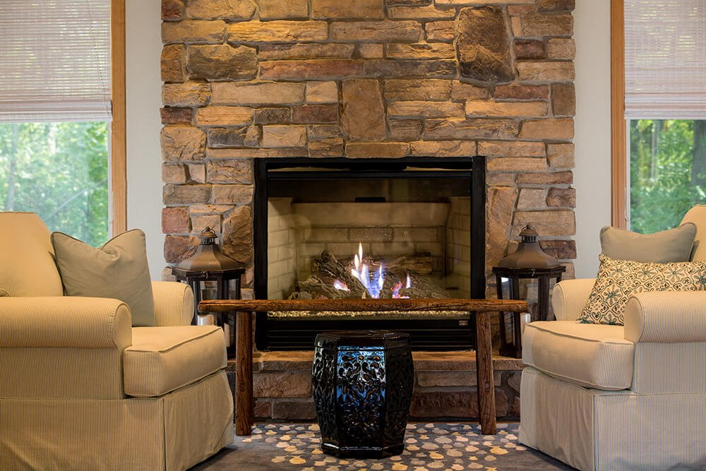 The bold stone fireplace really anchors the cottage look of this home, giving it a timeless appeal without taking away from the modern convenience and sleekness of the layout.
