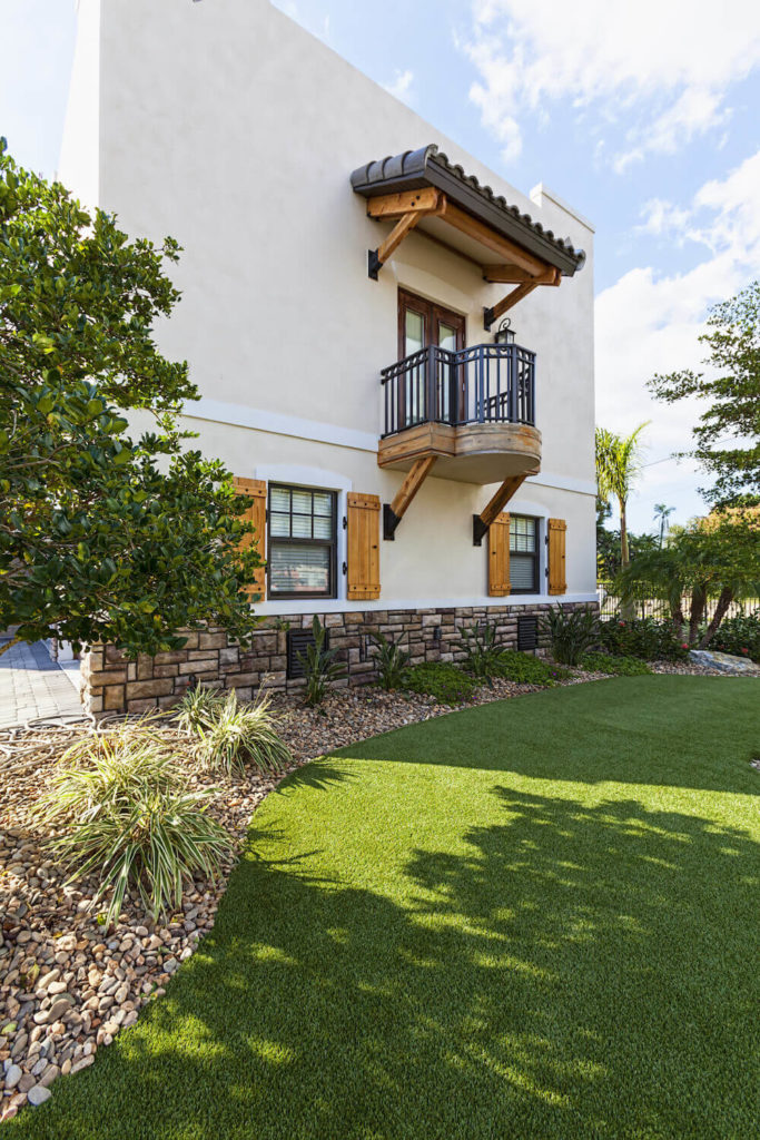 This hillside is covered in a nice patch of astroturf. The caretakers of this space no longer have to worry about how to navigate the challenges of lawncare with this lovely turf installed.