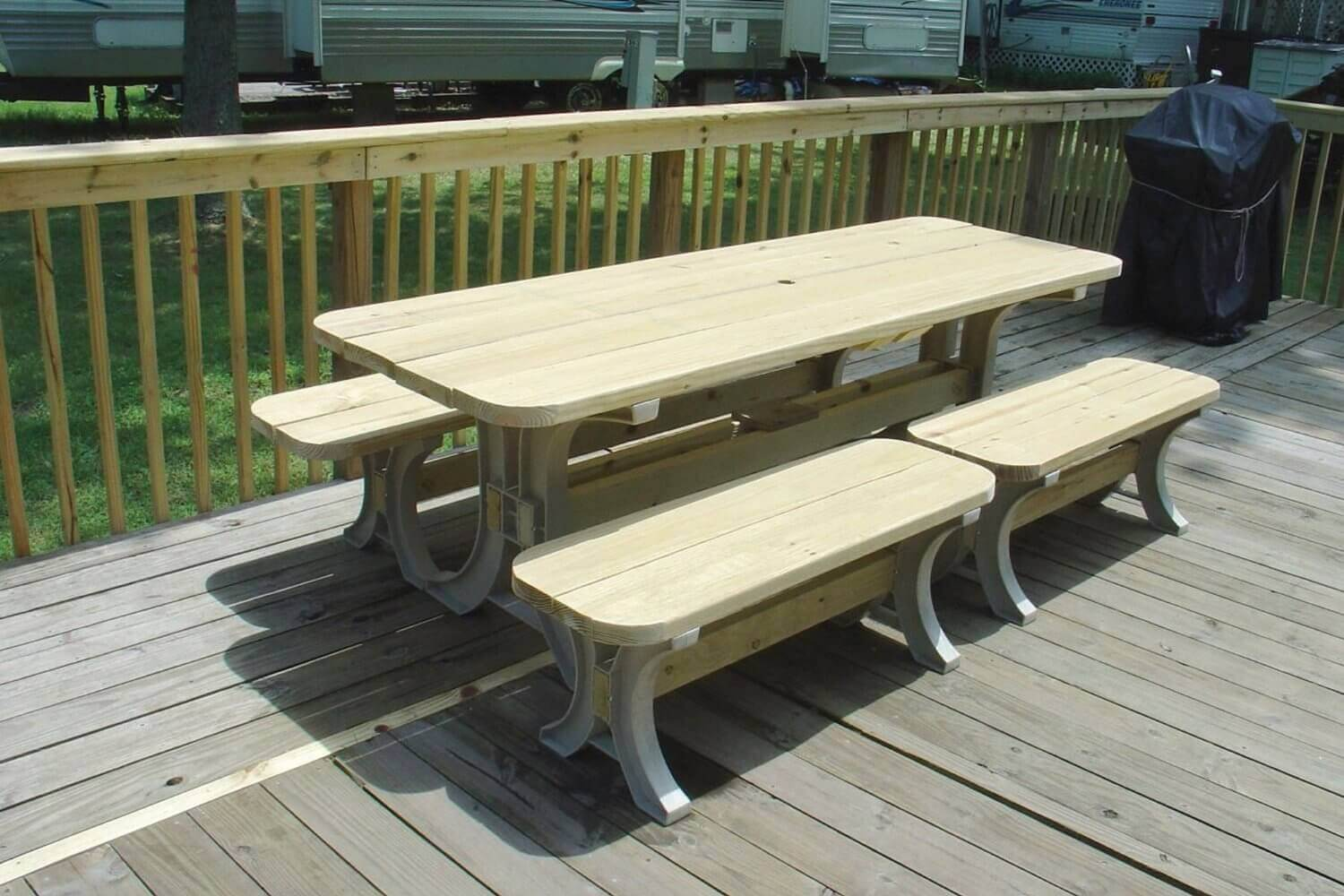This picnic table has a fantastic and classic look. The table is elongated for more space and there are two sets of benches to accommodate many people. This lovely table is in a lower cost range and has great value.