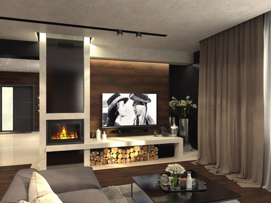 This area features a bold white marble fireplace and shelving component, offering storage for firewood and framing the entertainment equipment. It's a nice rustic touch within the larger modern design.
