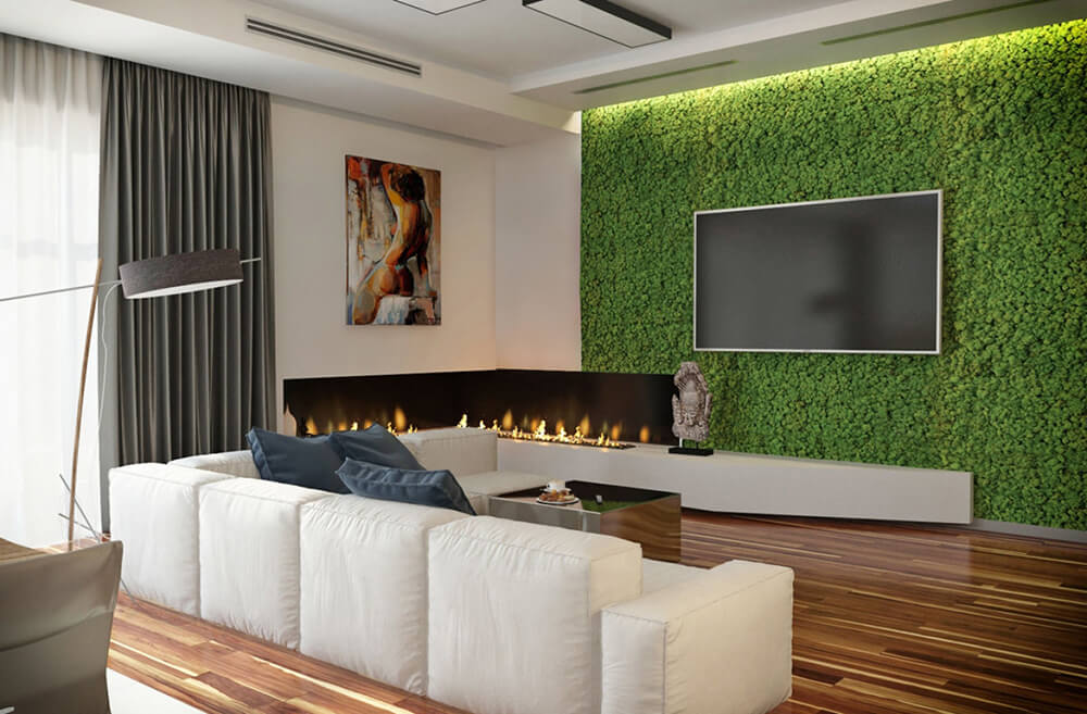 Here's a much closer look at the living wall, bordering a corner with an embedded gas fireplace as well. Lights tucked into the ceiling make the greenery positively glow.