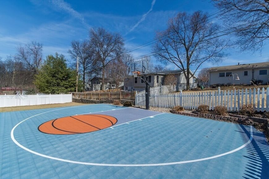 Here is a fabulous basketball court with a painted key. This court was designed with a passion for playing basketball.