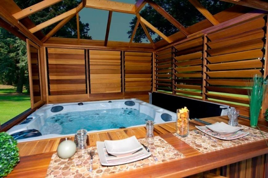 This gazebo is built to fit snugly around this hot tub, creating a cozy and private retreat to enjoy the water. With glass tops you can lay back, relax in privacy, and watch the stars.