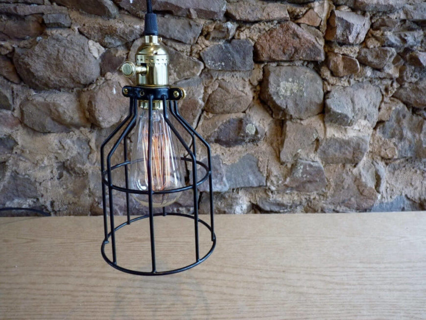 This hanging light features a brass dimmer knob on the socket and includes a 60 watt Edison light bulb and an extra-long 14 foot cloth cord.
