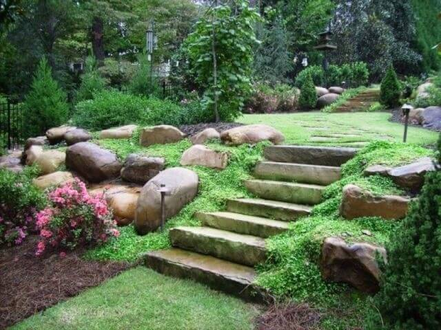 Here is a small set of stone steps. Rather than being constructed out of individual stones, these steps are carved from very large stones. The stones are partially covered by moss which gives them a good patina and blends them with the landscape.