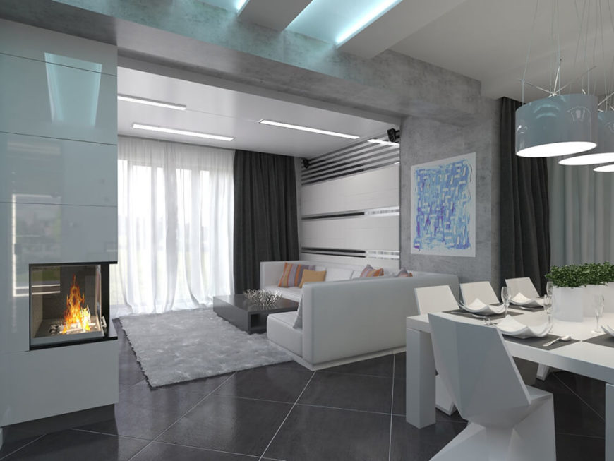 The contemporary open plan design makes for cozy functional crossover. Here we see the white dining room table meeting in the same space as the living room sofa and fireplace.