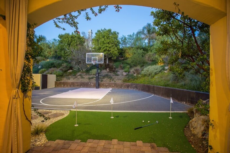 This half court is a great space to practice shots. It is particularly useful for anyone learning because there is a hill placed strategically behind the hoop. This will ensure that any missed shots roll right back to the players.