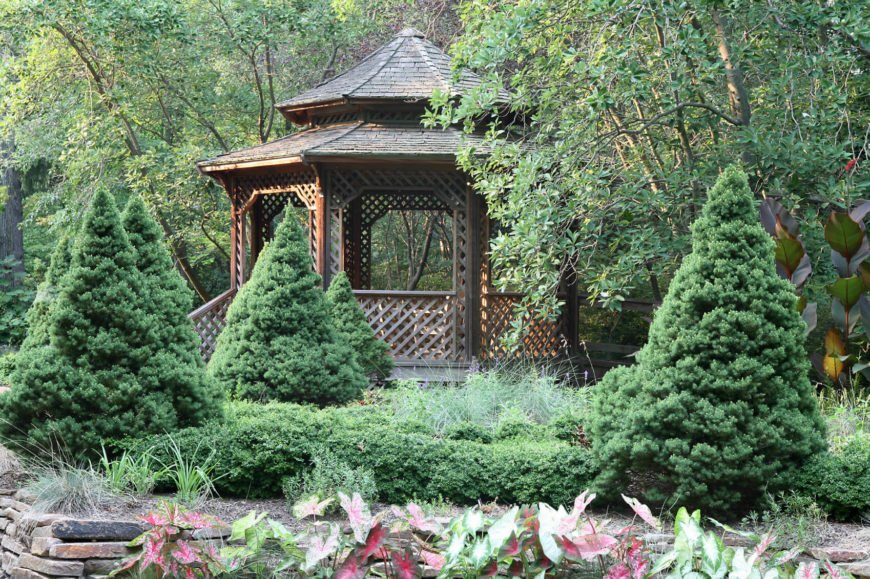 This stylish gazebo is tucked away amongst the trees. This forest-adjacent hideaway is a great place to escape to when you need to relax near the outdoors.