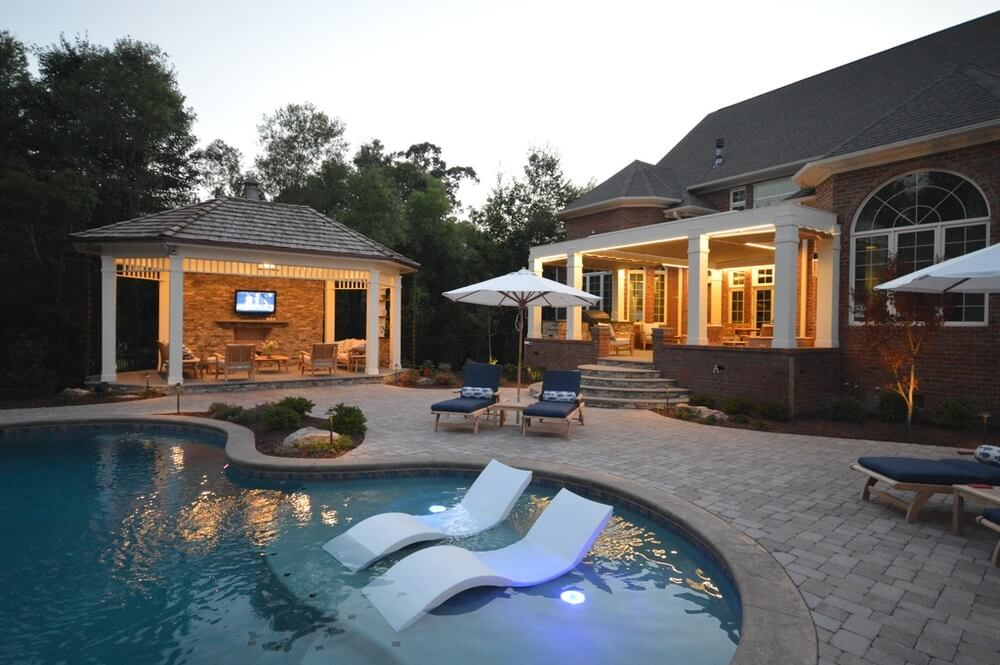 This gazebo is equipped with television, furniture, and lights. It makes a great little home away from home out by the pool. You will have everything you need and still be a stone's throw away from taking a nice relaxing swim.