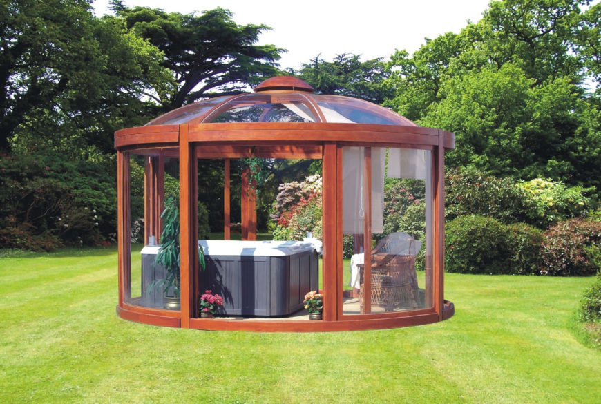 This enclosed hot tub with a glass paneled gazebo is the perfect space for looking out over your property in comfort and relaxation. Your vision will be slightly impeded but you will have protection from the weather.