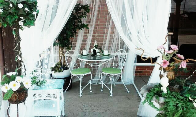 This gazebo has a ample number of white sheer drapes wrapped around the pillars. These elements enhance the space and can make your gazebo the perfect spot for weddings and high end parties.