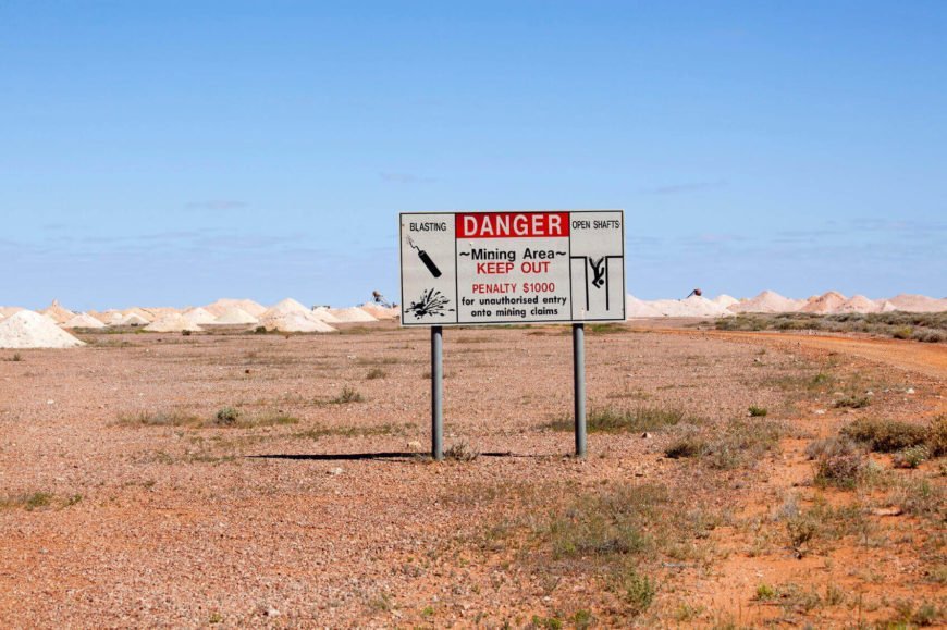 Standing out against a seemingly lunar landscape, this warning sign seems like something out of a Road Runner cartoon.