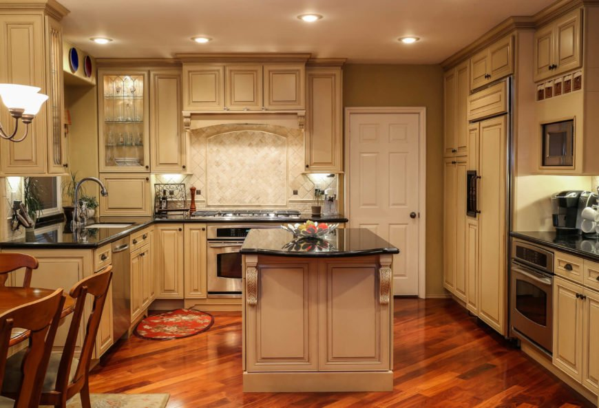 This kitchen uses pleasant and warm sandy tones mixed with rich browns and reds. The wonderfully curved ornamentation makes this space a great example of Mediterranean design.