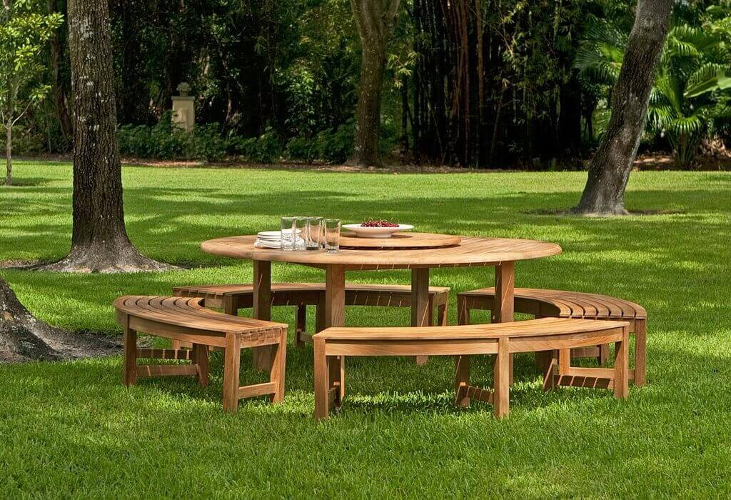 Here is a great circular picnic table with detached benches. This is a high end picnic table with ample space for all kinds of meals. This sophisticated picnic table will surely become the preferred gathering spot in your backyard.