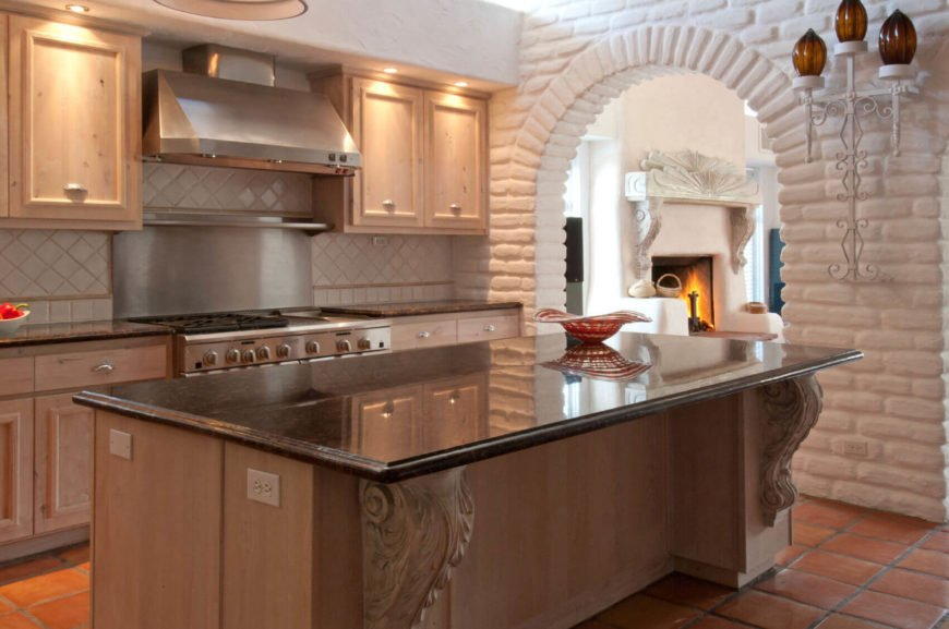 Brick can provide great texture to your Mediterranean style kitchen. The tiled backsplash pictured here is a great addition to this kind of design.