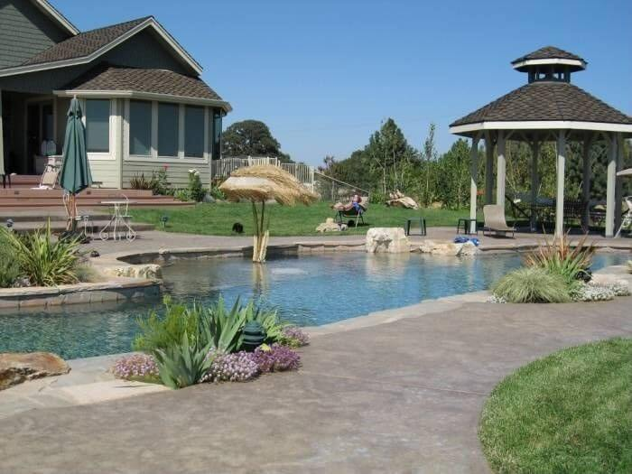 This poolside gazebo houses a pleasant eating table so your poolside cookout will have the perfect place to eat not far from the water.