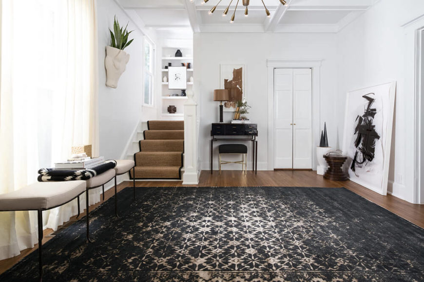 A faded black and tan rug creates a lively and polished look for an entry, study, or basement.